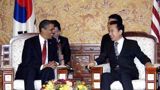 U.S. President Barack Obama talks with South Korean President Lee Myung-Bak on Thursday in Seoul, South Korea.