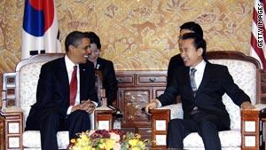 President Obama talks with South Korean President Lee Myung-Bak on Thursday.