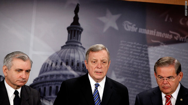 Senate Majority Whip Dick Durbin, center, with Sens. Jack Reed, left, and Robert Menendez, works Friday for the weekend vote.