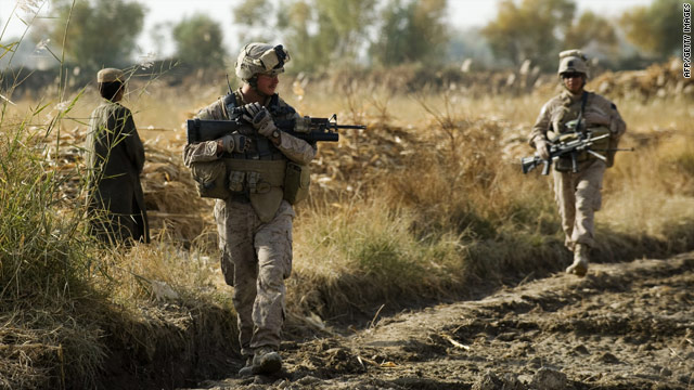 U.S. Marines patrol part of Afghanistan's Helmand province Tuesday with Afghan soldiers.