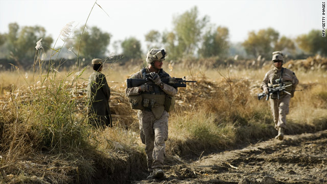 U.S. Marines patrol with Afghan soldiers in Helmand Province, Afghanistan, on Tuesday.