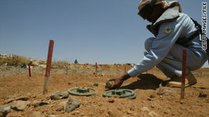 A worker attempts to clear landmines along the border between Jordan and Syria in July 2008.