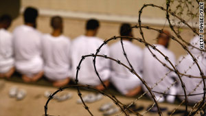 Detainees at the Guantanamo Bay detention center kneel during a prayer on October 28.
