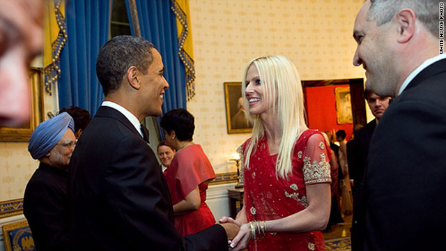 President Obama greets Michaele Salahi in a reception line at Tuesday's state dinner. The White House says she wasn't invited.