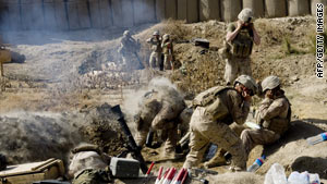 U.S. Marines fire mortar rounds from their forward operating base in Helmand Province, Afghanistan.