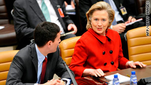 Hillary Clinton talks with British Foreign Secretary David Miliband at the NATO foreign ministers meeting in Brussels.