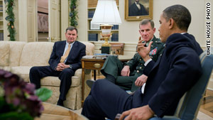 President Obama meets with U.S. Ambassador to Afghanistan Karl Eikenberry, left, and Gen. Stanley McChrystal on Monday.