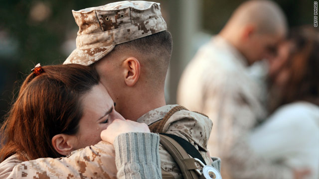 Marine Corporal Adam Marano hugs his wife Melissa Marano on November 3 at Camp Lejeune, North Carolina.