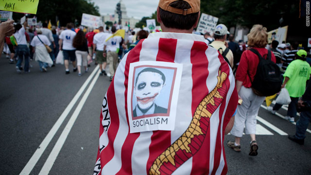 Protesters march through Washington at a Tea Party Express rally on September 12.