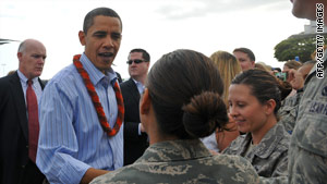 President Obama shakes hands with Air Force personnel at Hickam Air Force Base after arriving in Hawaii on Thursday.