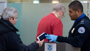 A TSA official checks a passenger's ID at Ronald Reagan Washington National Airport on Tuesday.