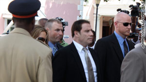 John Travolta, center, and his wife, Kelly Preston, enter the courthouse in the Bahamas last month.