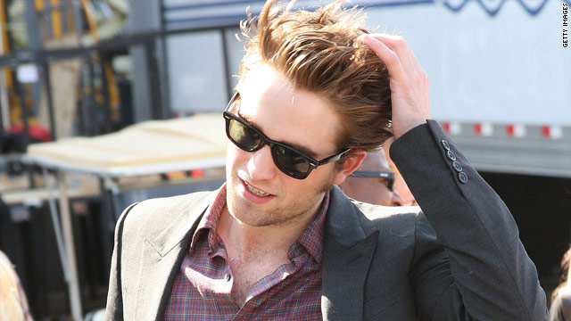 Robert Pattinson says that rumors of a love affair between him and Kristen Stewart are just that -- rumors.