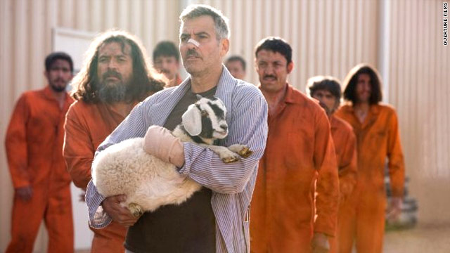 """George Clooney and a friend take in the scene in """"The Men Who Stare at Goats."""""""