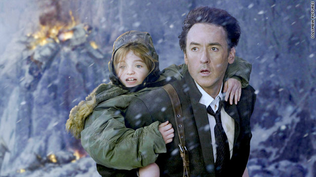 "John Cusack and Morgan Lily flee destruction in ""2012."""