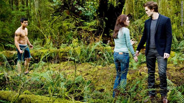 Jacob (Taylor Lautner) watches as Bella (Kristen Stewart) and Edward (Robert Pattinson) share a moment.