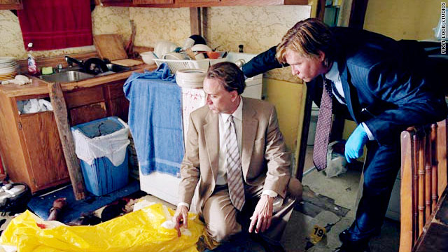 "Nicolas Cage and Val Kilmer size up a crime scene in ""Bad Lieutenant: Port of Call New Orleans."""