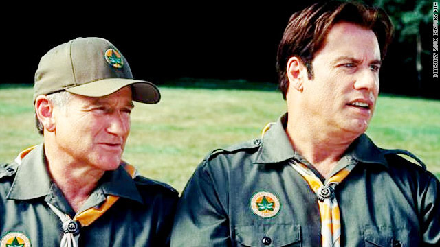 "John Travolta and Robin Williams find the meaning of manhood in ""Old Dogs."""