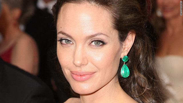 Angelina Jolie has penned an op-ed piece for Newsweek the same day President Obama accepted the Nobel Peace Prize.