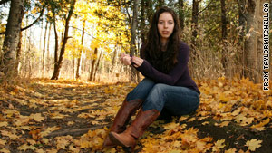 Up-and-coming Canadian folk singer Taylor Mitchell was killed by coyotes, park officials say.