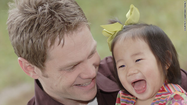 Steven Curtis Chapman sits with his daughter Maria. She died when accidentally struck in his family's driveway.