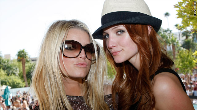 Ashlee Simpson-Wentz (right) defends her sister Jessica in the December issue of Women's Health magazine.