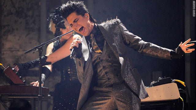 Adam Lambert's controversial AMA performance does not appear to be hampering his album sales.