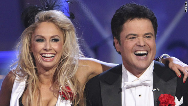 "Professional dancer Kym Johnson and Donny Osmond are the new champions of ""Dancing With the Stars."""