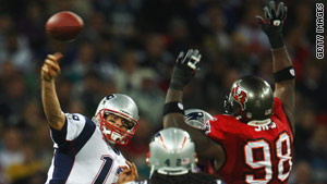 Tom Brady launches another pass during the Patriots' victory against the Buccaneers.