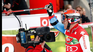 Cuche salutes his victory in the season-opening giant slalom in Austria.