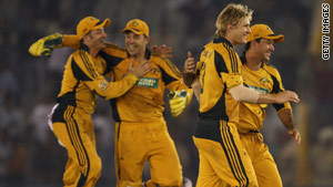 Australian players celebrate a Shane Watson wicket in their 24-run victory.
