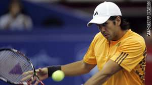 Fernando Verdasco remains on course for the World Tour Finals after going through in Valencia.