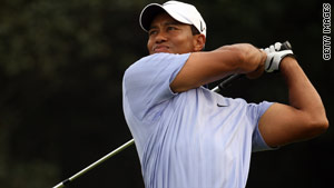 Woods carded a second successive five-under-par 67 to share the halfway lead in Shanghai.