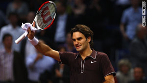 Top seed Roger Federer salutes the crowd after easing through to the semifinals in Basel.
