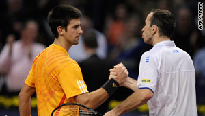 Djokovic (left) shakes hands with Stepanek at the conclusion of their semi in Basel.