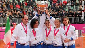 Italy celebrate the 4-0 Fed Cup final win over the United States on Sunday.