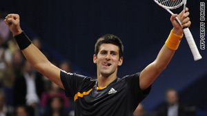 Novak Djokovic celebrates after beating Roger Federer for the third time in five meetings this year.