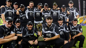 New Zealand captain Daniel Vettori celebrates victory over Pakistan with his team-mates.