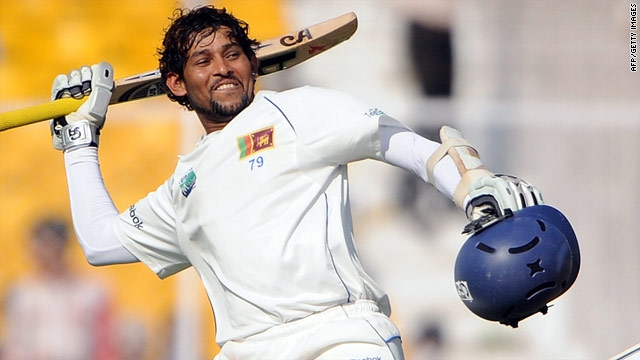 Dilshan celebrates his 10th Test century to help Sri Lanka move to within 151 runs of India's first innings total.