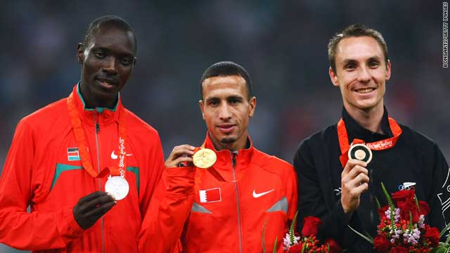 Ramzi (C) holds his Olympic gold medal in Beijing, alongside Asbel Kipruto Kiprop (L) and Nicolas Willis (R)