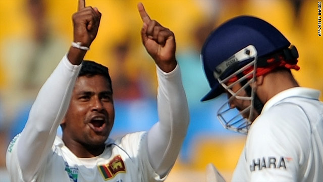 Sri Lanka spinner Rangana Herath celebrates after dismissing India opener Virender Sehwag.