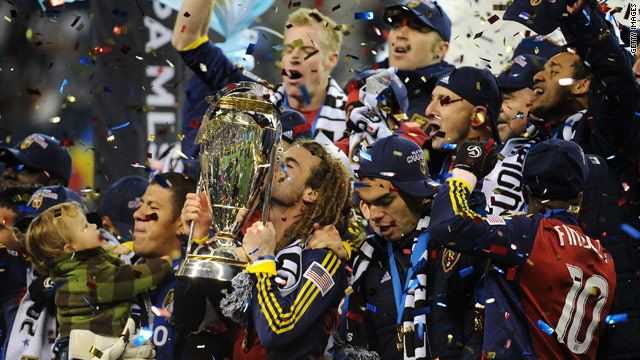 Kyle Beckerman of Real Salt Lake kisses the MLS Cup trophy as he and his teammates celebrate their win over the L.A. Galaxy in the MLS Cup final.