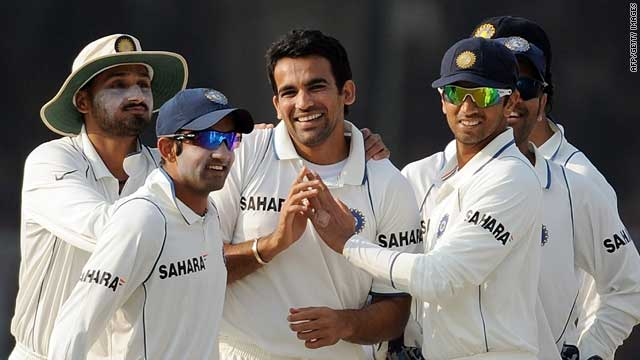 Zaheer Khan (center) is congratulated after taking Dilshan's wicket.