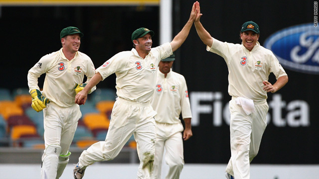 Michael Hussey, left center, and Marcus North celebrate as Australia take another wicket against the West Indies.