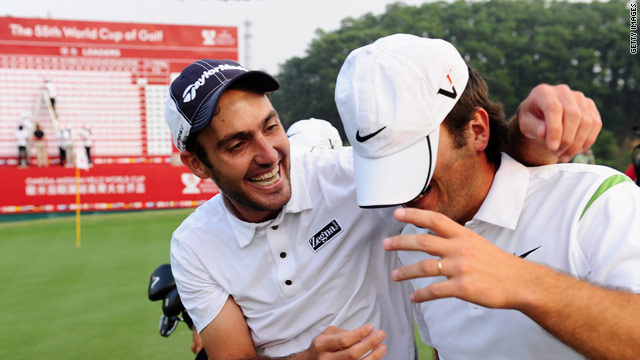 Edoardo (left) and Francesco celebrate on the final green after holing the winning putt.