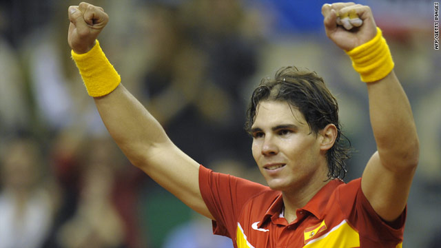 Rafael Nadal celebrates his opening victory over Tomas Berdych in the Davis Cup final.