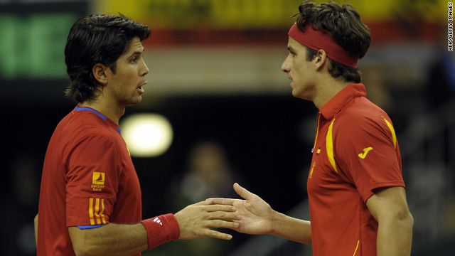 Fernando Verdasco, left, congratulates doubles partner Feliciano Lopez after clinching the Davis Cup title.