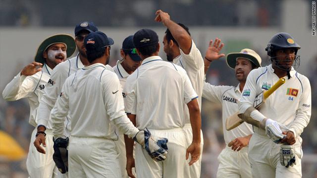 India players celebrate taking the wicket of  Kumara Sangakkara on their way to a series victory.