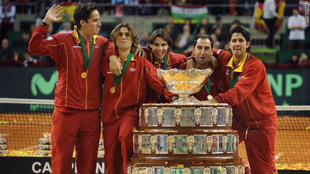 The victorious Spanish Davis Cup team celebrate retain their trophy in Barcelona on Sunday.