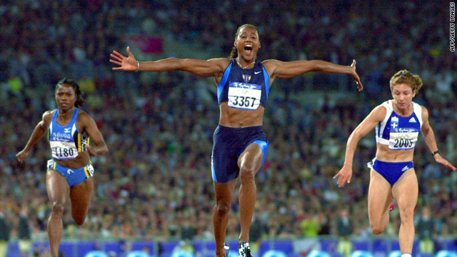 Marion Jones celebrates beating Katerina Thanou (right) to win the 100m meters at the Sydney Olympics.